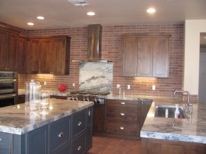 Unexpected brick backsplash really gives this kitchen the country feel the owners were looking for.