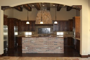 My sister's kitchen! Designing runs in the family.  She did an amazing job in this grand kitchen.  Brick, travertine, copper sink, wood beams, custom cabinets and incredible rock work.  It's the whole package…kudos, sistah!