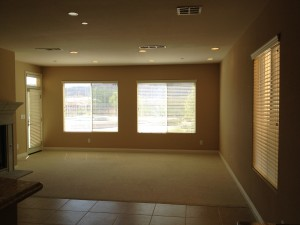 BEFORE photo of  Dark and unassuming family room
